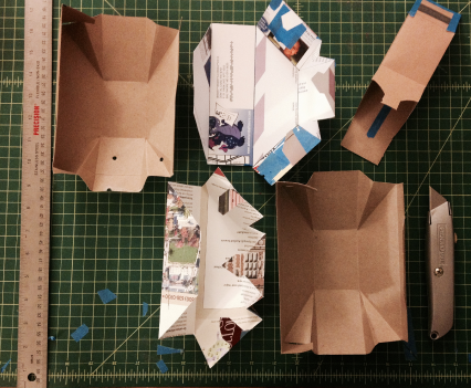 Testing various Pods with cereal boxes and brochures.